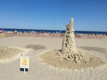 Hampton Beach, NH, sand sculptures, sand art, art, castles, beach, fun, adventure, travel, journey, authorblog, blogseries, writer, author, booknerd, nerd, books, fantasy, mustread, storytelling, blue, white, high-five, waves, ocean, sea, story, blogger, book blog, dream,