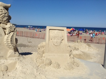 Charlotte Preston, Hampton Beach, NH, sand sculptures, sand art, art, castles, beach, fun, adventure, travel, journey, authorblog, blogseries, writer, author, booknerd, nerd, books, fantasy, mustread, storytelling, blue, white, high-five, waves, ocean, sea, story, blogger, book blog, dream,